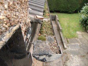 Blocked asbestos cement gutter